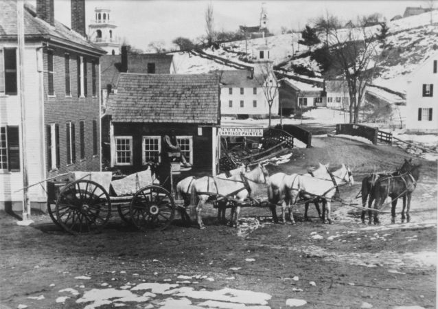 wagon passes by tavern